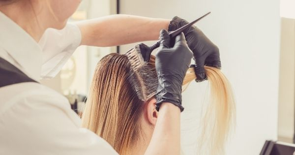 Cosmetology professional doing hair coloring